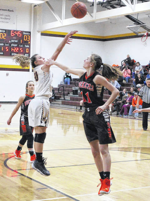 Meigs junior Kassidy Betzing releases a shot attempt over a Nelsonville-York defender during the first half of a TVC Ohio contest on Feb. 5 in Rocksprings, Ohio.