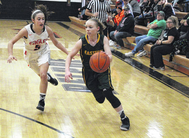 Eastern junior Jess Parker drives past a BHS defender during a TVC Hocking girls basketball game on Dec. 16, 2017, in Belpre, Ohio.