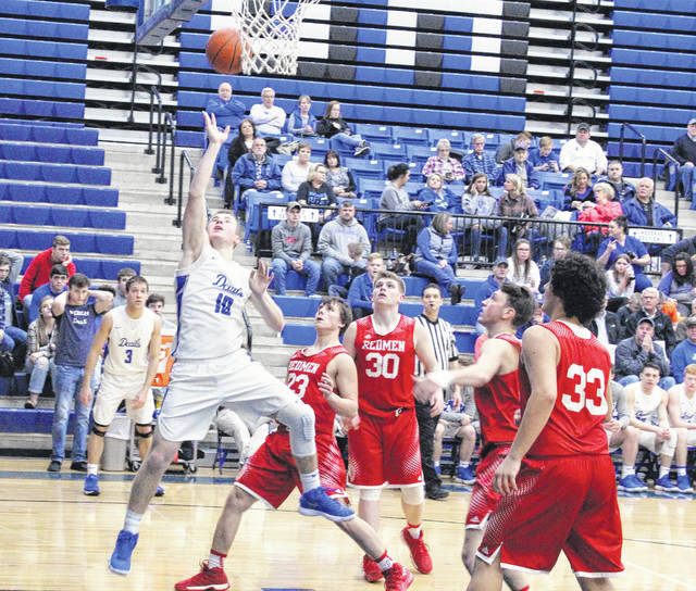Gallia Academy junior Justin McClelland (10) releases a shot attempt in front of four Rock Hill defenders during the second half of a Jan. 23 OVC boys basketball contest in Centenary, Ohio.