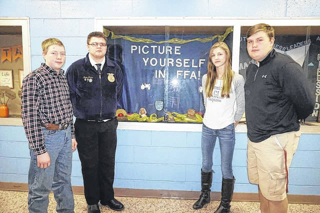 """Four students at the Mason County Career Center were given grants for """"starter farms"""" recently by the West Virginia Farm to School Community Development Group. In the coming years, the students will return at least one of the animals they breed to keep the project going. Pictured, from left, and the amount they were granted, are freshman Michael King, $1,500; freshman Kevin Jones, $1,800; junior Brianna Haga, $1,800; and senior Lucas Diehl, $1,800."""