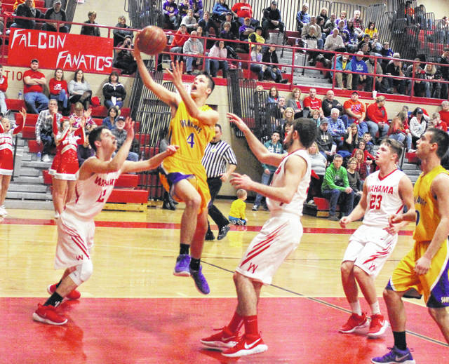 Southern junior Weston Thorla (4) releases a shot attempt over a Wahama defender during a Jan. 24 TVC Hocking boys basketball contest at Gary Clark Court in Mason, W.Va.