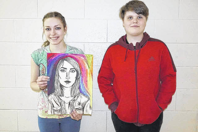 Wahama High School art students Camryn Tyree, left, and Reese Roush (not pictured) were recently chosen as participants in the Congressional Art Show in Charleston, as representatives of District 3. In addition, Peyton Ingels, right, an eighth grader at Wahama won third place in the 3D category of the West Virginia Youth Art Month Show in Parkersburg. While their winning entries remain on display, Tyree is shown with a self portrait she drew in class.