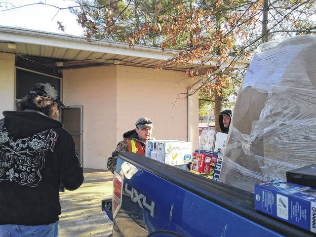 Workers from the City of Point Pleasant help out by unloading items for an auction which will be held for Lewis Bryant Jr. this Sunday at the Youth Center. The auction will have various donated items. The earnings from the event will help Bryant's family with travel and medical expenses.