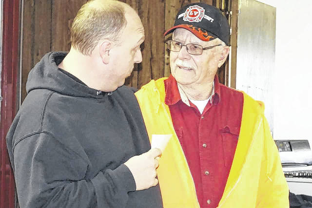 Mason firefighter George Ray VanMatre, right, is pictured as he talks with fellow fireman R.C. Faulk during a reception held in VanMatre's honor Sunday. VanMatre officially retired from Station House 5 last week after serving there as a volunteer for 61 years.