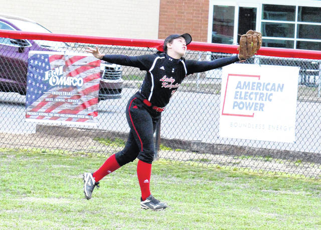 PPHS senior Lila Beattie hauls in a flyball during the Lady Knights' 8-0 loss to Lincoln County on Monday in Point Pleasant, W.Va.
