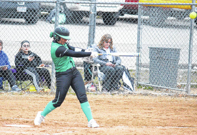 EHS senior Sidney Cook blasts her first of two home runs in the Lady Eagles' 23-2 victory over Miller on Tuesday in Tuppers Plains, Ohio.
