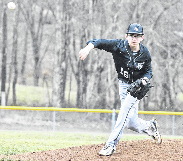 River Valley pitcher Chase Barber (16) delivers a pitch during the Raiders 13-8 loss to Nelsonville-York on Tuesday night in Bidwell, Ohio.