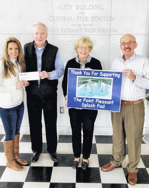 "The McMillan family, along with Mid-Atlantic Construction, recently purchased the ""water rainbow"" component for the Point Pleasant Splash Pad. Pictured from left are City Clerk Amber Tatterson, Bob and Becky McMillan and Mayor Brian Billings. The city hopes to break ground on the splash pad at Krodel Park this year."