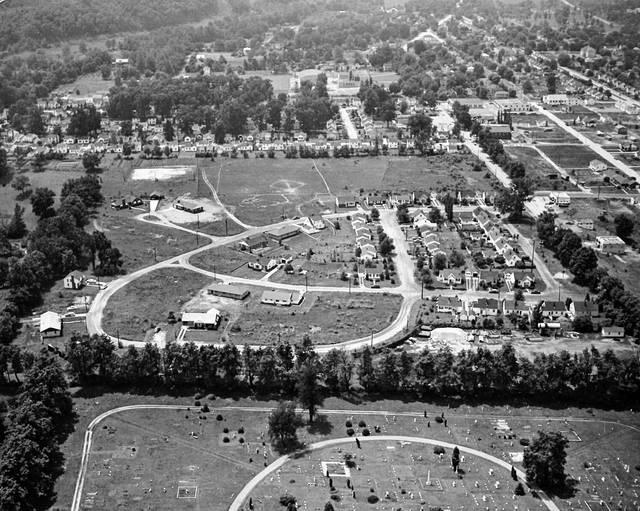 This undated aerial photo shows what appears to be Suncrest Cemetery, Mossman Circle, an empty space which will someday contain Pleasant Valley Hospital, then the Park Drive addition and the old Point Pleasant High School and gymnasium in the distance.