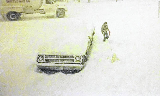 Jane Broyles used to live on Eastern Avenue near Lincoln Avenue. She can be seen here in the snow, which nearly buried their pickup truck.