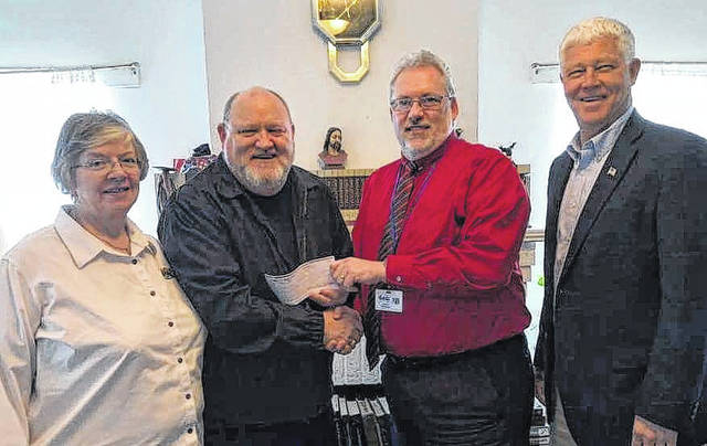 The 2018 Community Easter Cantata offering was recently presented to John Machir, director of the Mason County Homeless Shelter in Point Pleasant. Record-breaking attendance during the two-night presentation on March 24- 25, donations amounted to $950, which will be used for supplies and renovations in the shelter's kitchen. Pictured from left are Koneda Devrick, choir member; Larry Jones, choir director; John Machir, shelter director; and Rick Handley, choir member and county commissioner.