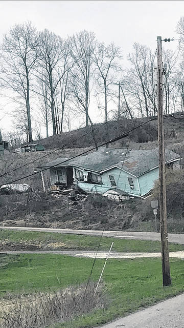 The second floor to this abandoned home on Supper Club Road in Hartford reportedly fell last weekend. The structure is hovering above the roadway.
