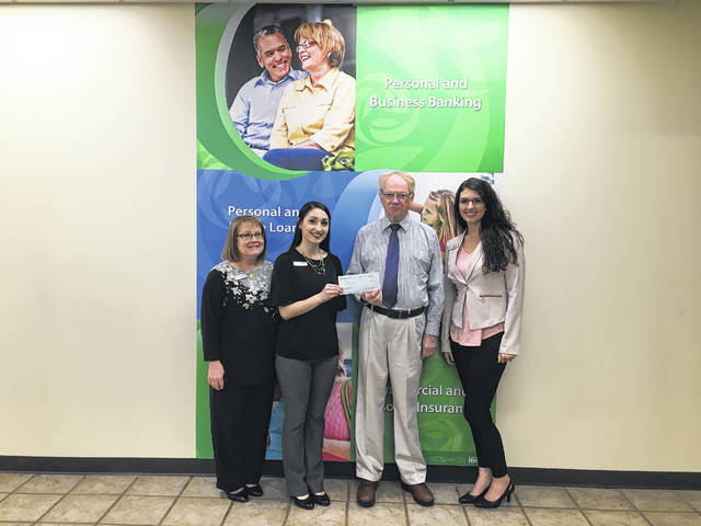 The Peoples Bank Community Foundation presented Charles Humphreys with a $3,000 donation for Main Street Point Pleasant. Pictured from left to right is Personal Banker Roxanne Weaver, Branch Manager Valerie Johnson, Charles Humphreys, and Personal Banker Katelyn Hendrix.