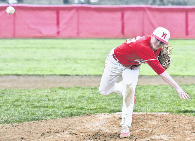 Wahama senior Dalton Kearns (23) delivers a pitch during of the White Falcons' 10-8 victory over Trimble on Monday in Mason, W.Va.