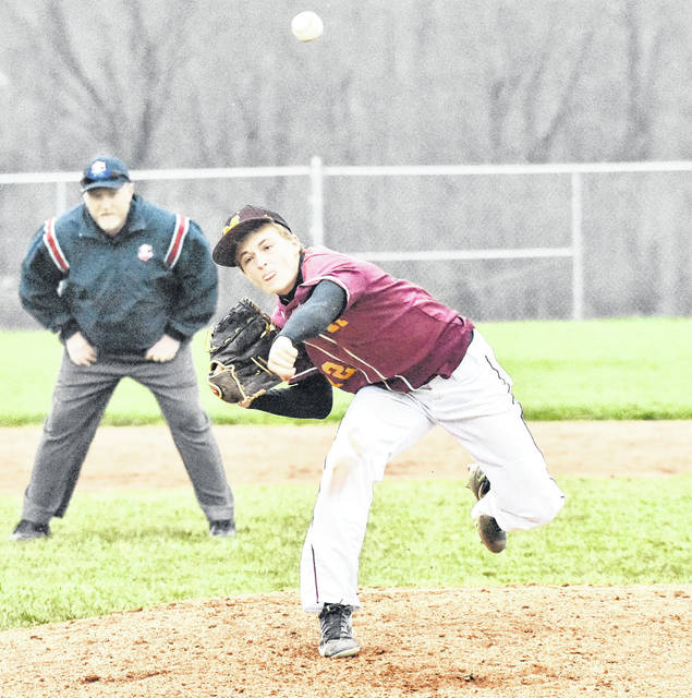 MHS junior Wesley Smith (12) delivers a pitch during the Marauders 12-5 win over Vinton County on Friday night in Meigs County.