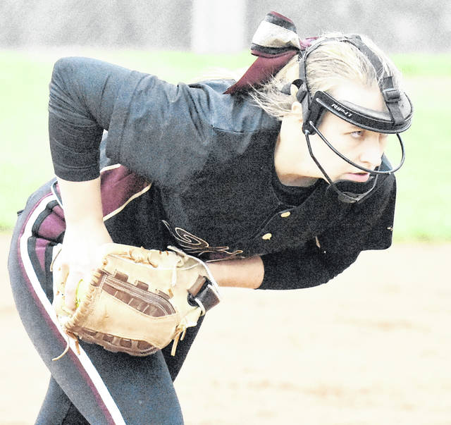 MHS sophomore Breanna Zirkle (9) sets to deliver a pitch during the Lady Marauders 5-4 victory over Vinton County on Friday in Rocksprings, Ohio.