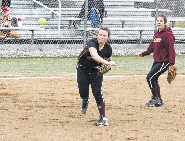 Meigs freshman Chonslyn Spaun throws to first base in front of teammate Jerrica Smith, during the Lady Marauders' 6-5 win on Monday in Rocksprings, Ohio.