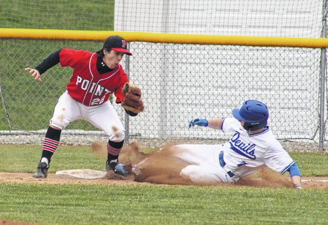 Point Pleasant freshman Tanner Mitchell goes to apply a tag to Gallia Academy's John Stout during a steal attempt at third base on Tuesday night in a non-conference baseball game at Bob Eastman Field in Centenary, Ohio.
