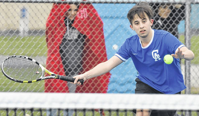 GAHS senior Pierce Wilcoxon attempts to return volley during a match against Jackson on April 5 in Centenary, Ohio.