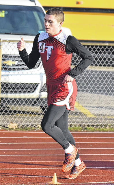 Wahama junior Jacob Lloyd hits stride during the 4x800m relay event on Friday, March 31, at the 2018 Herbert Hoover Invitational held at Laidley Field in Charleston, W.Va.