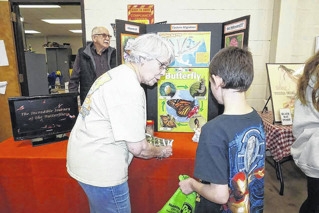 A young boy learns the life stages of the monarch butterfly at the Outdoor Youth Expo.