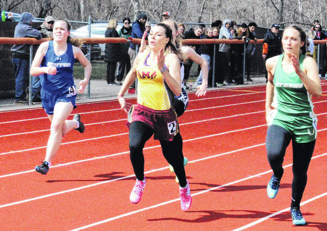 Meigs junior Kassidy Betzing runs past a trio of competitors in the 100m dash at the Rocky Brand Invitational on March 31 in Nelsonville, Ohio.
