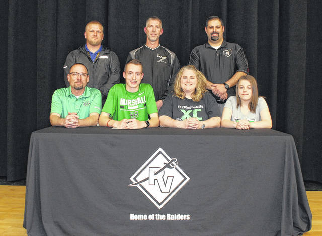 River Valley senior Nathaniel Abbot, seated second from left, will be continuing his cross country and track careers at the Division I level after signing a letter of intent with Marshall University on Wednesday, April 11, on the River Valley High School stage in Bidwell, Ohio. Nathaniel is joined in the front row, from left, by his father Matt, mother Heather and sister Lindsey. Standing in back are RVHS track coach Brent Smith, RVHS cross country coach Darin Smith and RVHS athletic director Richard Stephens.