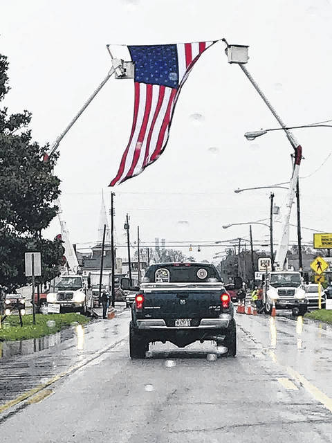 In a show of respect, Applachian Electric Power personnel provided the bucket truck arch along Jackson Avenue during the funeral procession for Shane Filkins, 23, Point Pleasant, on Sunday. Filkins, a Journeyman Lineman with the IBEW 317, was killed when a helicopter he was in recently crashed in Pennsylvania. Filkins had been working in that area stringing power lines for a new transmission project. Filkins' uncle addresses this show of respect in a letter to the editor appearing on Page 4.