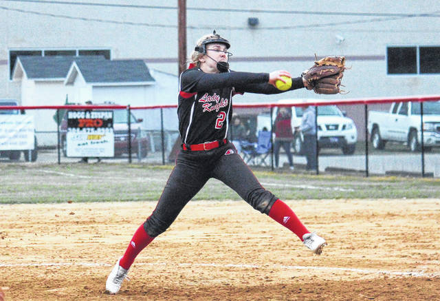 Point Pleasant sophomore Peyton Jordan winds up for a pitch during the Lady Knights' loss to Lincoln County on March 26 in Point Pleasant, W.Va.