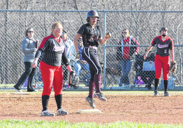 Meigs junior Taylor Swartz (center) pulls into second base for a double, during the Lady Marauders' 9-1 loss to Alexander on Friday in Rocksprings, Ohio.
