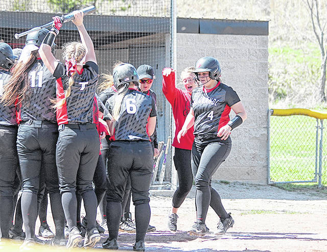Rio Grande's Mary Pica is congratulated by her teammates at home plate after hitting a fifth inning home run in Friday's game one win over Carlow. The RedStorm swept a twinbill from the Celtics by scores of 12-2 and 1-0.