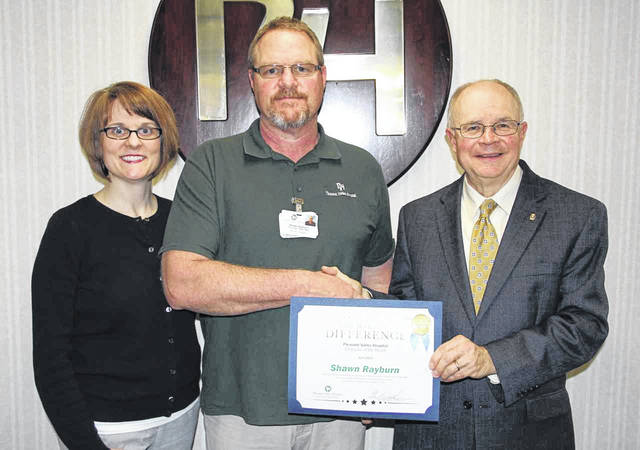 The Pleasant Valley Hospital Employee of the Month for April is Shawn Rayburn, pictured at center. Also pictured, Amy Mullins, director of rehabilitation, and Glen Washington, FACHE, PVH CEO.