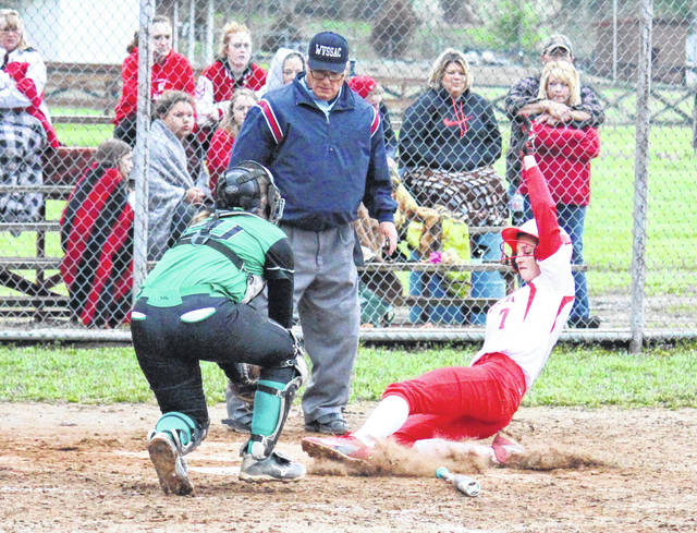 Wahama freshman Emma Gibbs (7) slides safely into home under a tag by Eastern freshman Kelsey Roberts, during the Lady Falcons' 14-8 victory on Wednesday in Hartford, W.Va.