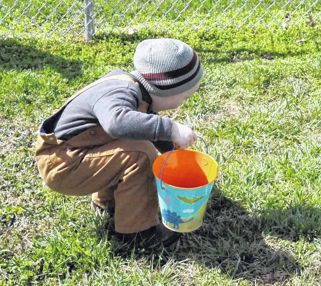 A young hunter finds exactly what he is looking for at the New Haven Easter egg hunt Saturday at the ballfield.