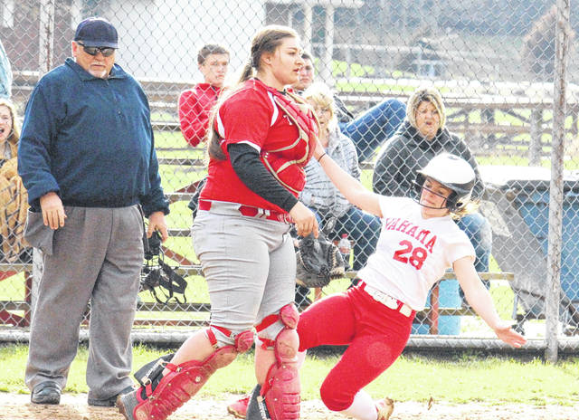 Wahama's Grace Haddox (28) slides safely into home during the Lady Falcons' 8-2 victory over Trimble on Monday in Hartford, W.Va.