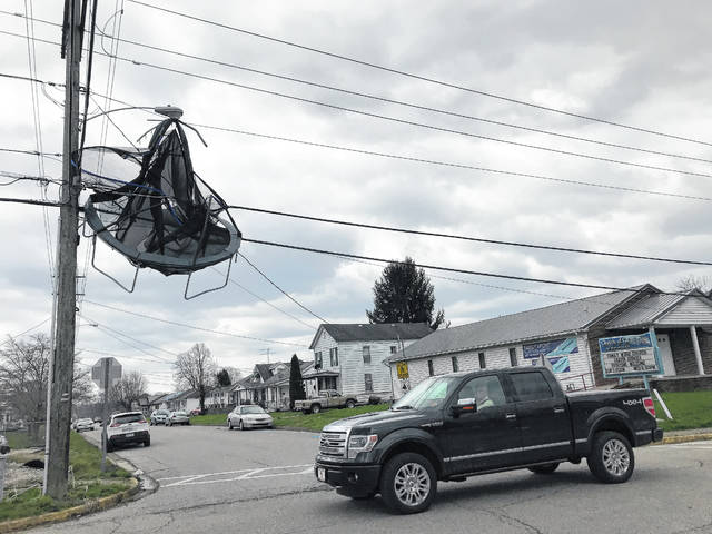 This trampoline caught in the power lines near Point Pleasant Primary School and the corner of 22nd Street and Lincoln Avenue was a stop for sightseers following Tuesday's storms.