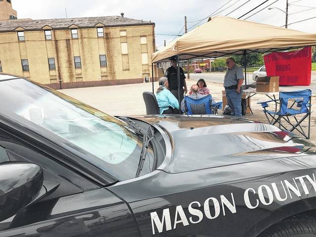 Members of the Mason County Prevention Coalition, Paula Gregory, Woody Moore and Rita Darst, volunteered at the Point Pleasant location for the 2017 Mason County Drug Take Back Day, along with Mason County Sheriff Greg Powers and Cpl. Ronnie Spencer of the sheriff's department.