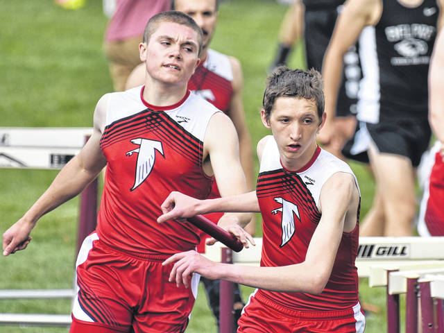 Wahama junior (right) takes the baton from teammate Jacob Lloyd during the 4x800-meter relay at the 2018 Tri Valley Conference Hocking Division track and field championships on Thursday in McArthur, Ohio.