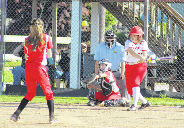 Wahama junior Alexis Mick belts out a pinch-hit single in the sixth inning of Tuesday night's Class A Region IV, Section 1 softball championship game against Calhoun County in Hartford, W.Va.