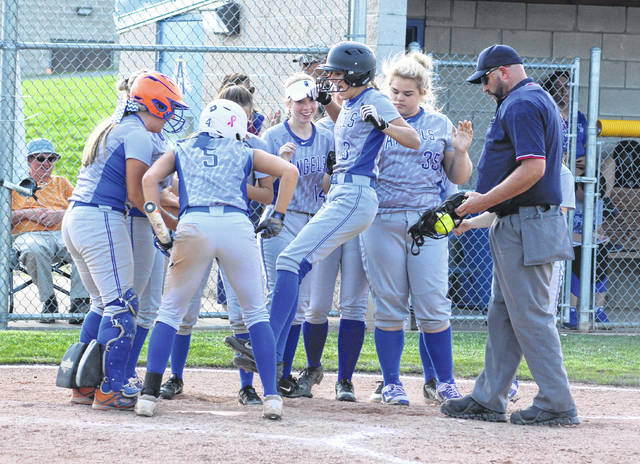 Gallia Academy sophomore Alex Barnes jumps in the air to land on home plate while celebrating a fourth inning home run on Wednesday night in a Division II sectional softball final against Unioto at the Eastman Athletic Complex in Centenary, Ohio.