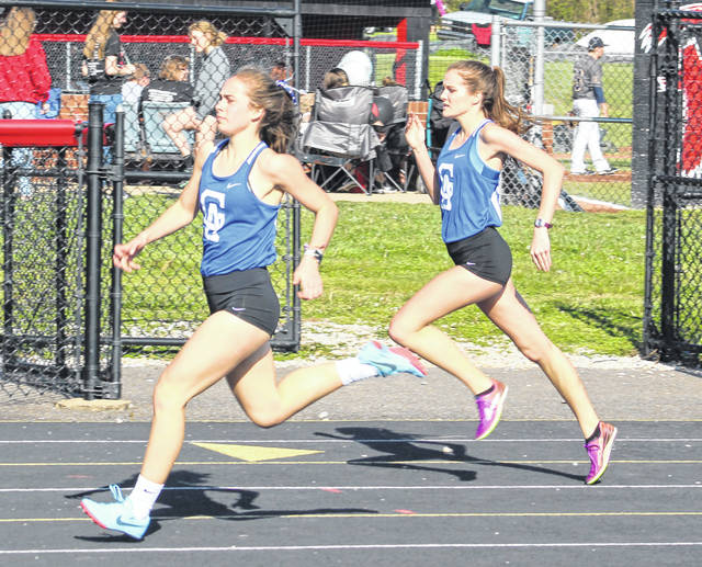 Gallia Academy freshman Sarah Watts, left, and sophomore Brooke Johnson both hit full stride during the 400m dash event held at the 2018 Battle for the Anchor on April 30 at OVB Track and Field in Point Pleasant, W.Va.