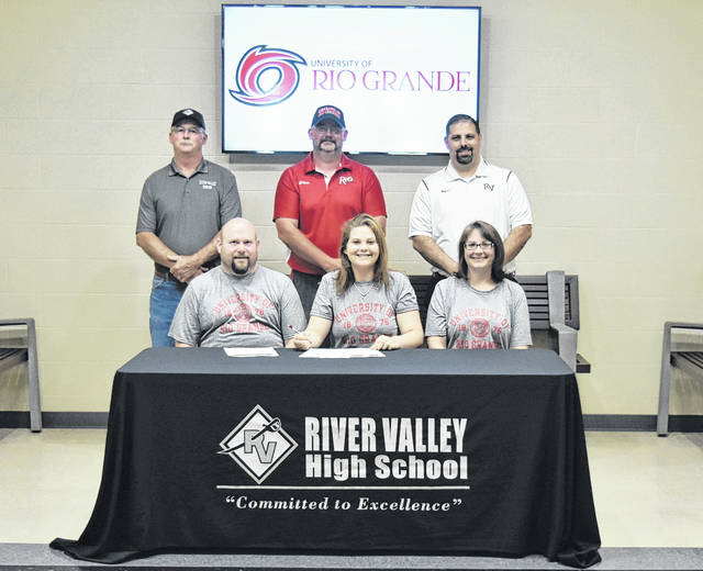 On May 16 at River Valley High School, senior Maddee Tabor signed a letter of intent to join the University of Rio Grande track and field team. Sitting in the front row, from left, are Bret Tabor, Maddee Tabor and Valerie Tabor. Standing in the back row are Chuck Wood, Burt Wood and Richard Stephens.