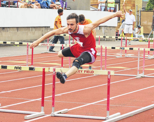 Wahama junior Brodee Howard clears an obstacle during the Class A 4x110m shuttle hurdles relay event on Friday at Laidley Field in Charleston, W.Va.