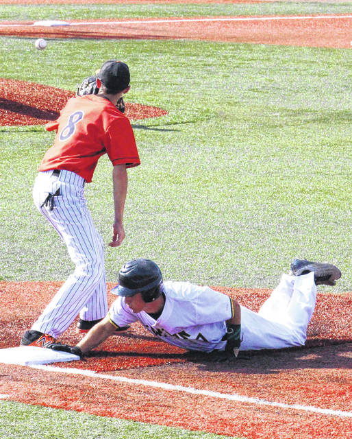 EHS junior Nate Durst dives safely back to first base, during the Eagles' one-run setback on Friday in Lancaster, Ohio.