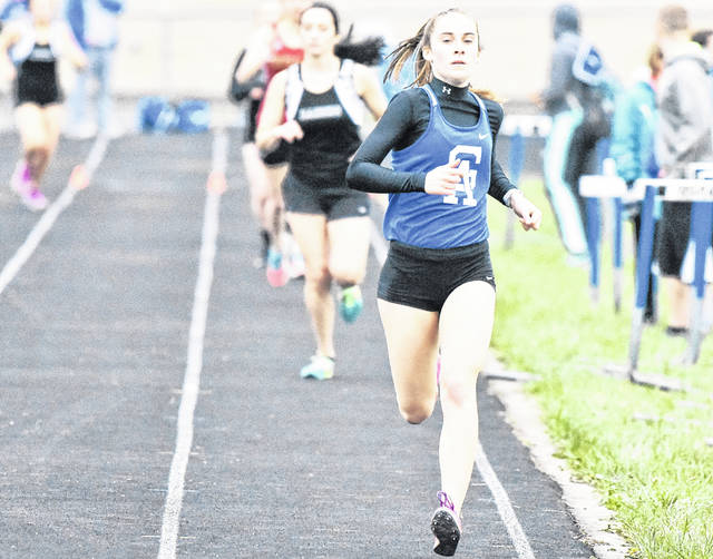 Gallia Academy freshman Sarah Watts strides toward the finish line during the 800m relay event at the 2018 Gallia County meet on April 10 at GAHS in Centenary, Ohio.