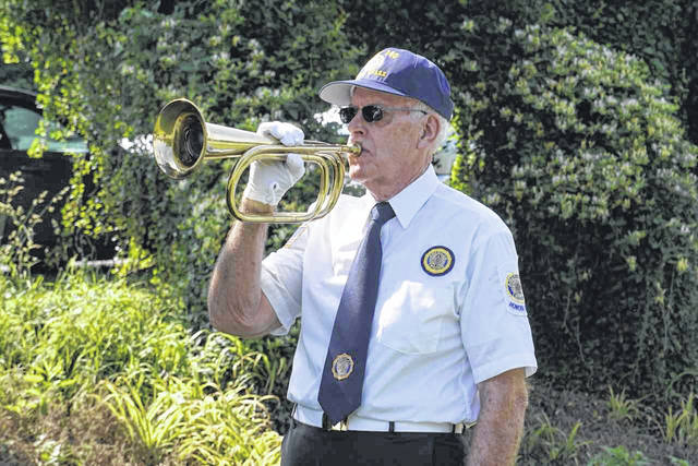 """The playing of """"Taps"""" is a part of the solemn remembrance held in the Bend Area on Memorial Day by the Stewart-Johnson V.F.W. Post 9926 and Smith-Capehart American Legion Post 140."""