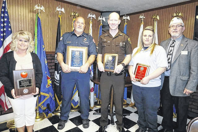 A number of awards were presented to leaders in their fields of work during the Loyalty Day Dinner at the Stewart-Johnson V.F.W. Post in Mason. Pictured from left, Shannon Korn, Post Teacher of the Year; Greg Kaylor, National Firefighter of the Year; Bryan Hill, District Police Officer of the Year; Holly Davis, District Emergency Medical Technician of the Year; and Post Commander Ray Varian.