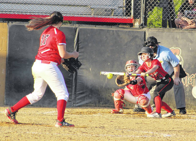 Point Pleasant junior Hannah Smith lays down a bunt during the sixth inning of Tuesday night's Class AA Region 4, Section 1 tournament game against Sissonville in Point Pleasant, W.Va.