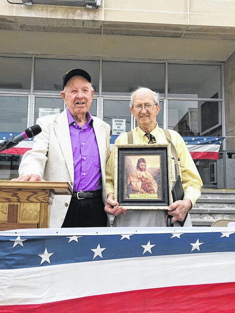 Pictured at right is Rev. Bud Richmond, recipient of the Paul Chapman Shepherd's Recognition Award. Also pictured, Fleming Young, Jr., of Apple Grove, a 99-year old WWII veteran who prayed for the military at the National Day of Prayer observance this week.