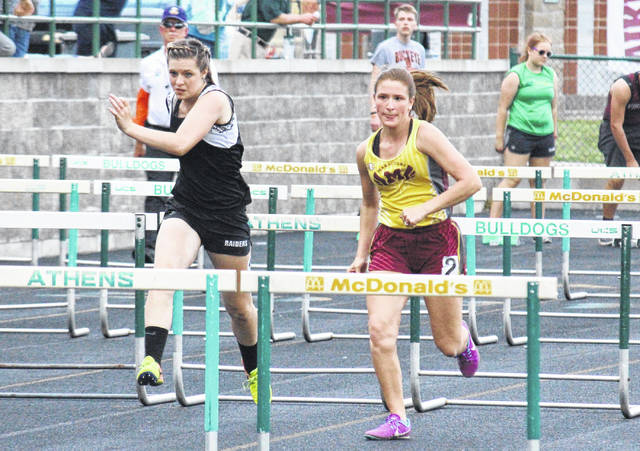 River Valley sophomore Gabrielle Gibson (left) and Meigs junior Lydia Edwards (right) run in the 100m hurdles, at the TVC Ohio Championships on Wednesday in The Plains, Ohio.